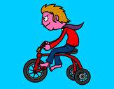 Disegno Ragazzo in triciclo pitturato su marcobois