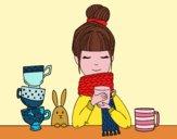 Ragazza con la sciarpa e tazza di tè